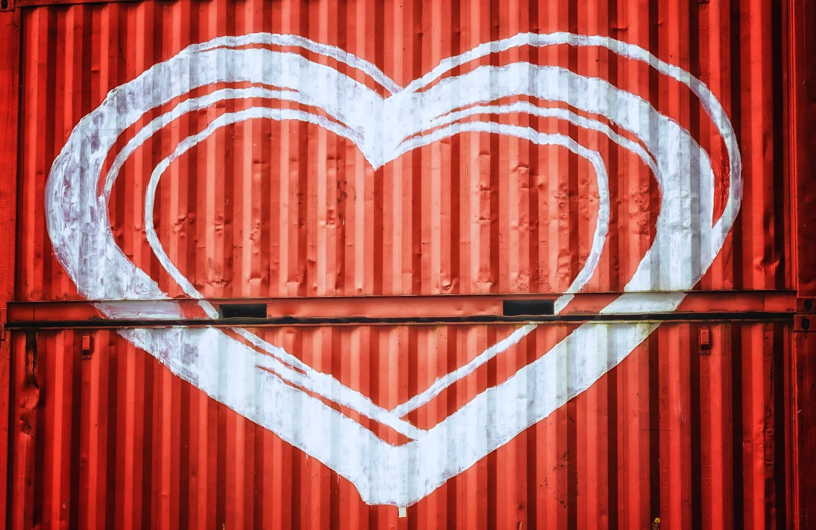 White heart drawn on red storage containers