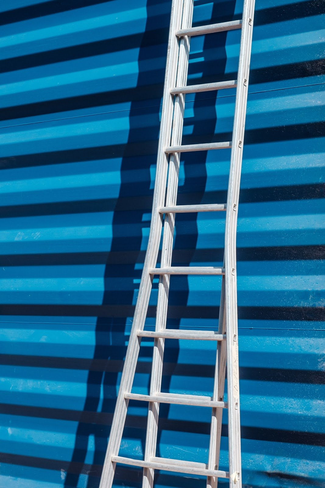 Ladder leaned against storage containers