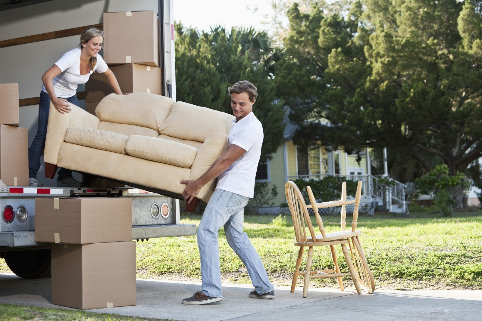 Man and woman moving a couch